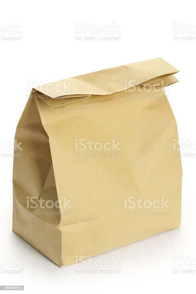 Closed brown paper bag isolated on a white background royalty-free stock photo