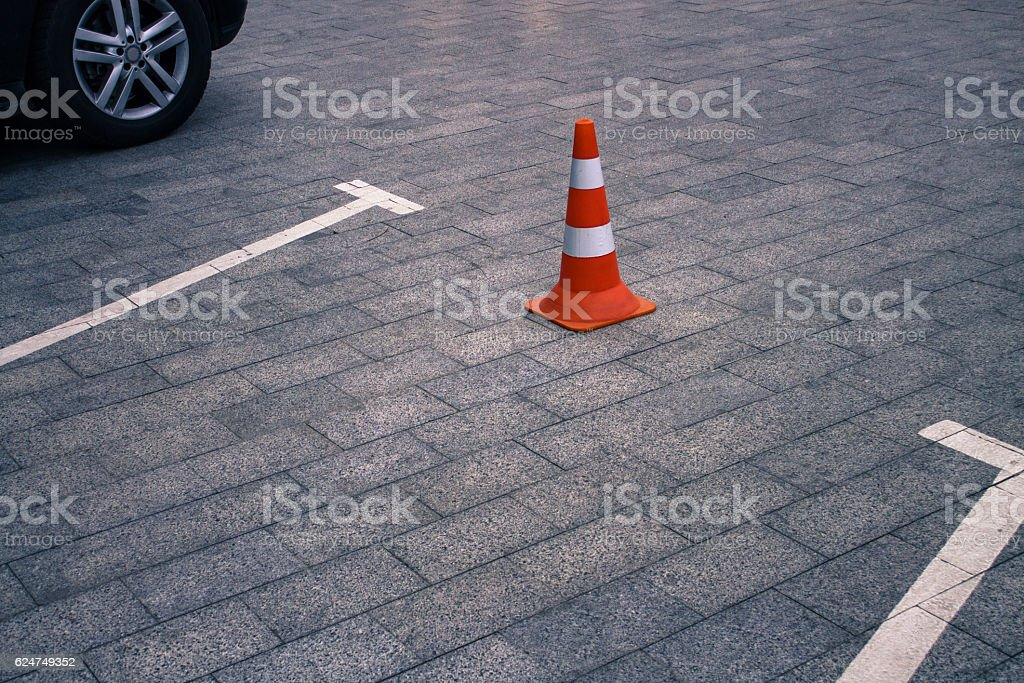 Closed car parking lot and traffic cone on street stock photo