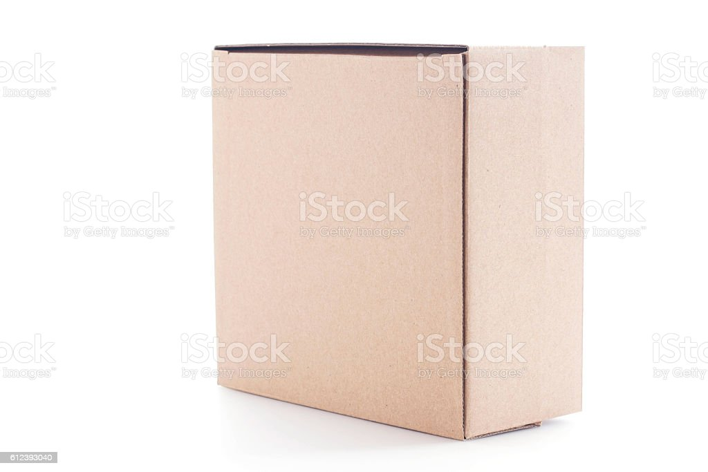 Closed cardboard box on white background. stock photo