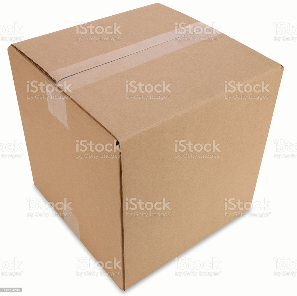 Closed cardboard box sitting in an empty white space royalty-free stock photo