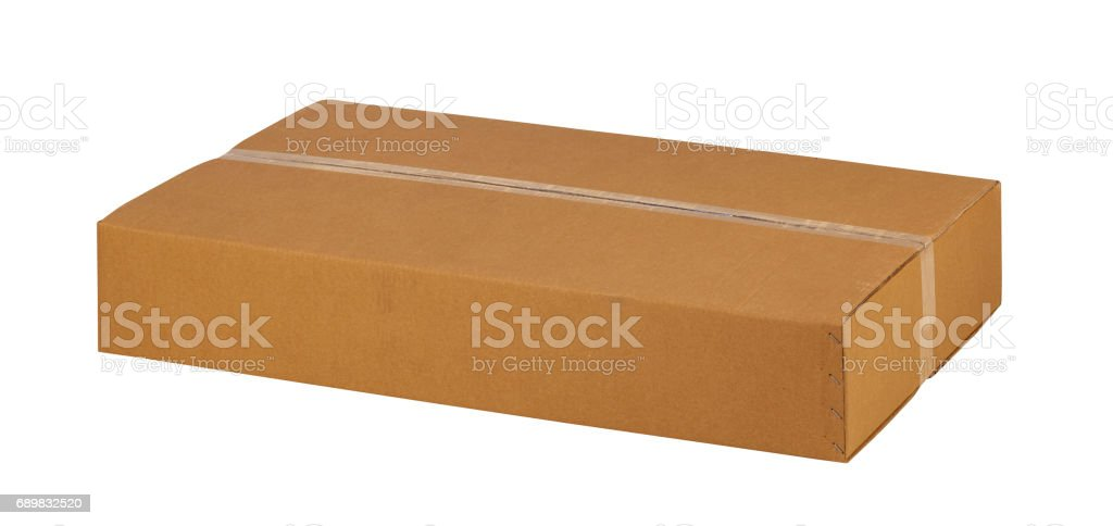 Closed cardboard box taped up and isolated on a white background. stock photo
