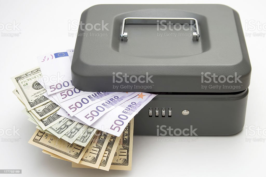 Closed cashbox with money on white royalty-free stock photo
