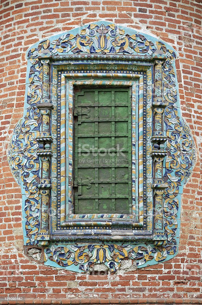Closed church window with glased ornate tile stock photo