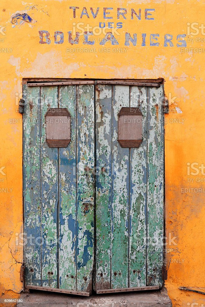 Closed door of Taverne des Boucaniers. Goree-Senegal. 1727 stock photo