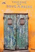 Closed door of Taverne des Boucaniers. Goree-Senegal. 1727