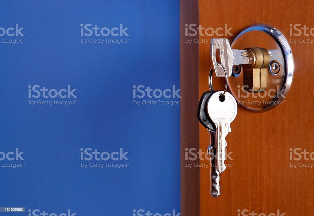 Closed door with keys in the lock stock photo