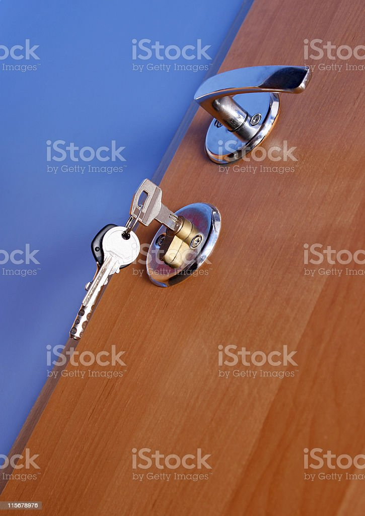 Closed door with keys stock photo
