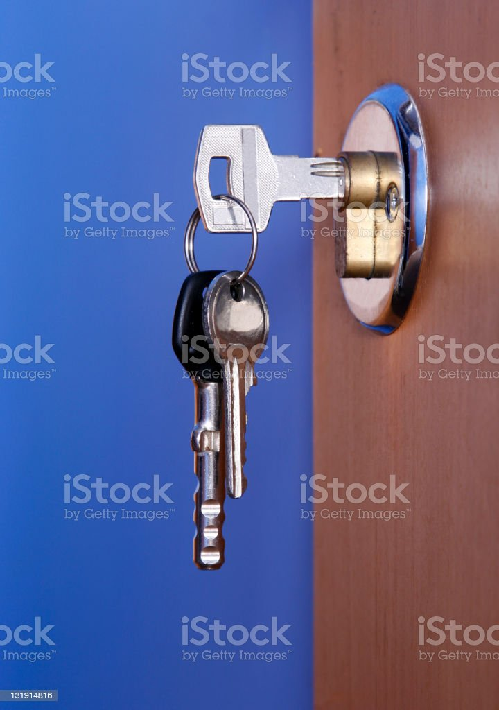 Closed door with keys royalty-free stock photo