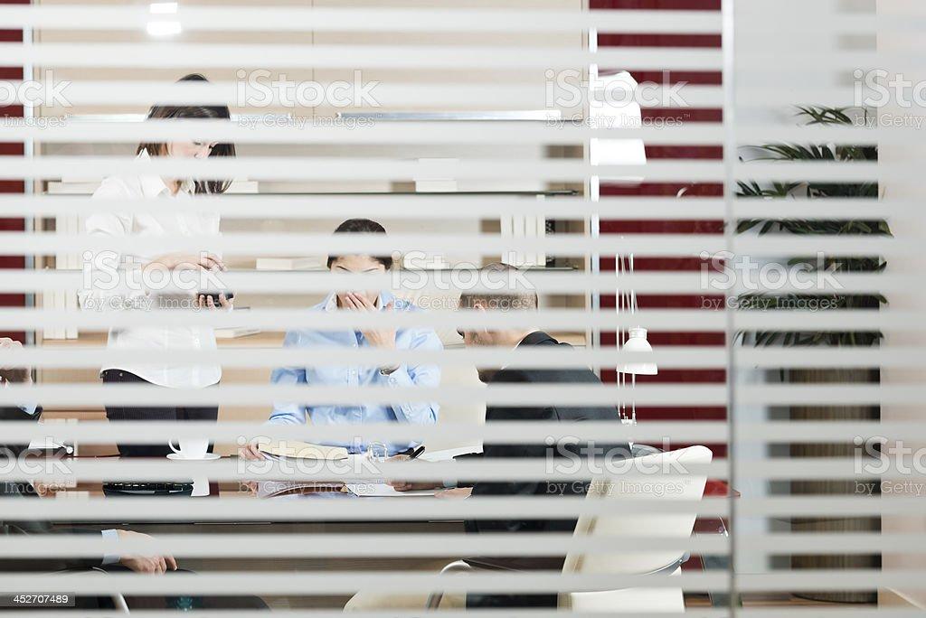 Closed doors meeting stock photo