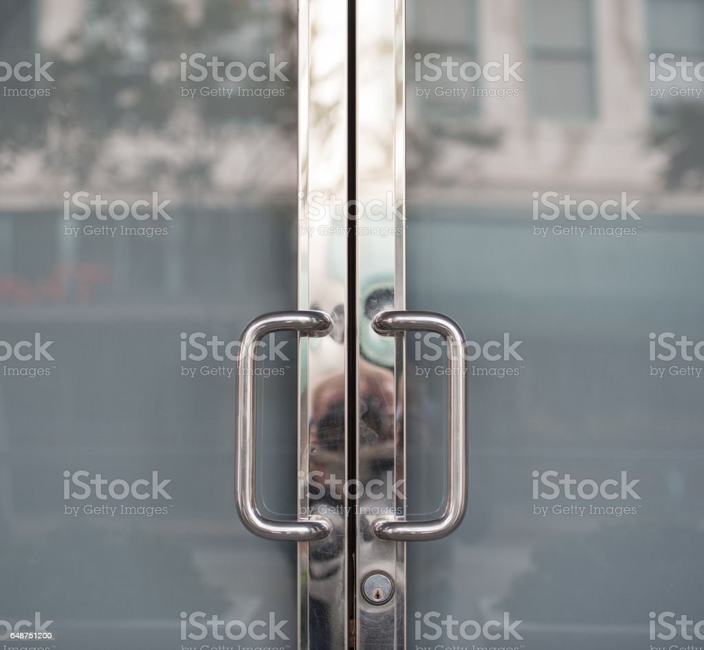 Closed doors, metal and glass stock photo