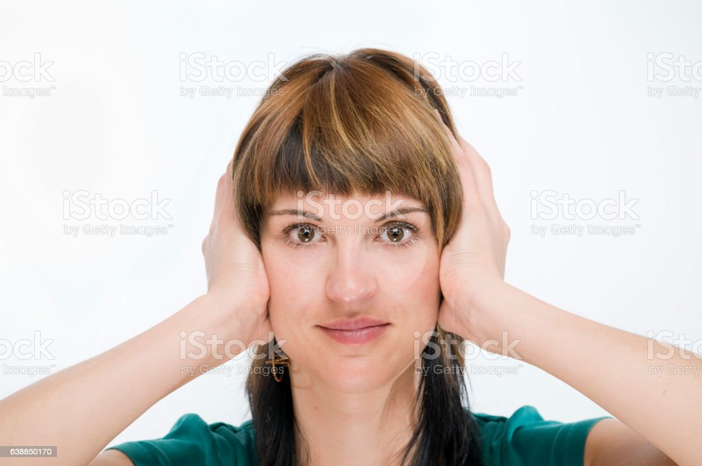 closed ears of woman stock photo