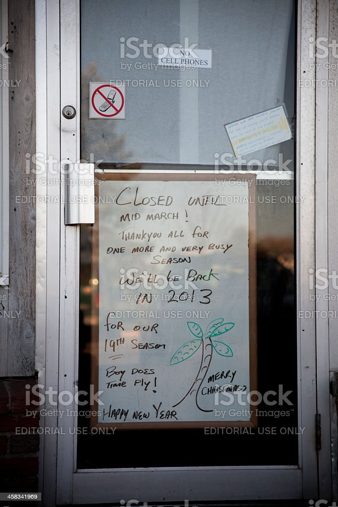 'Closed for season' poster on the cafee door royalty-free stock photo