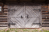 Closed gate in old wooden wall
