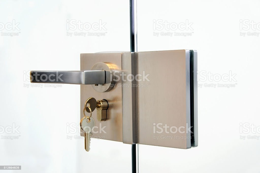 closed glass door with the key stock photo