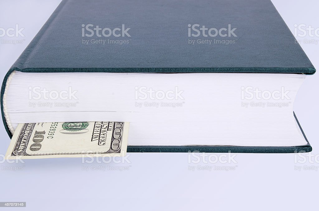 closed green book with a bookmark 100 USD royalty-free stock photo