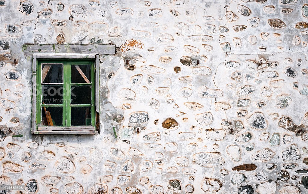 Closed green window on a bricked wall stock photo
