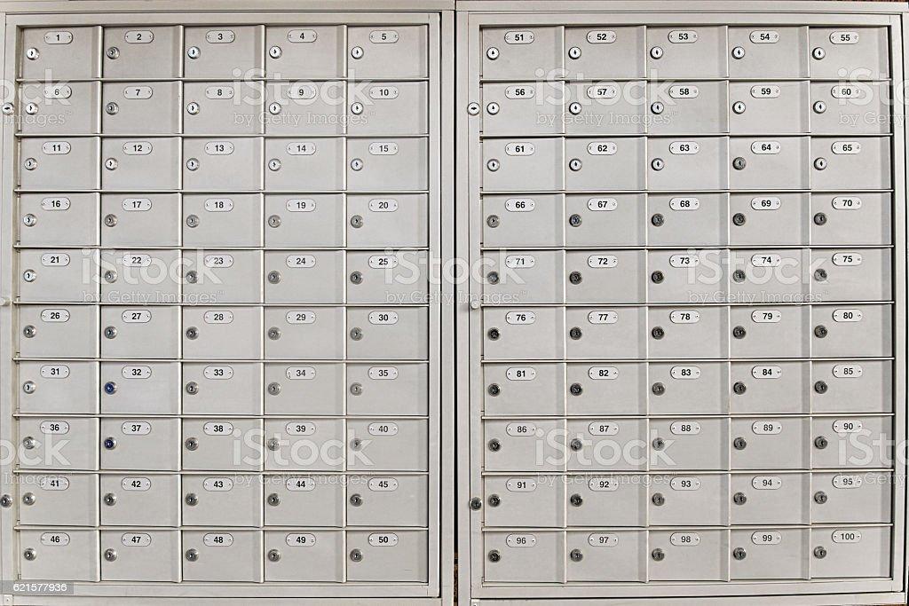 Closed, locked pigeon-hole messagebox or pidge stock photo
