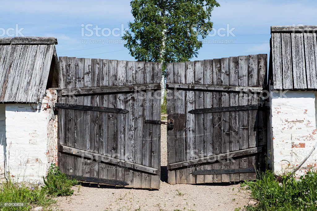 Closed old wooden gate in the countryside. stock photo