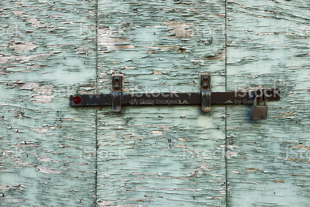 Closed peeling wooden shutter royalty-free stock photo