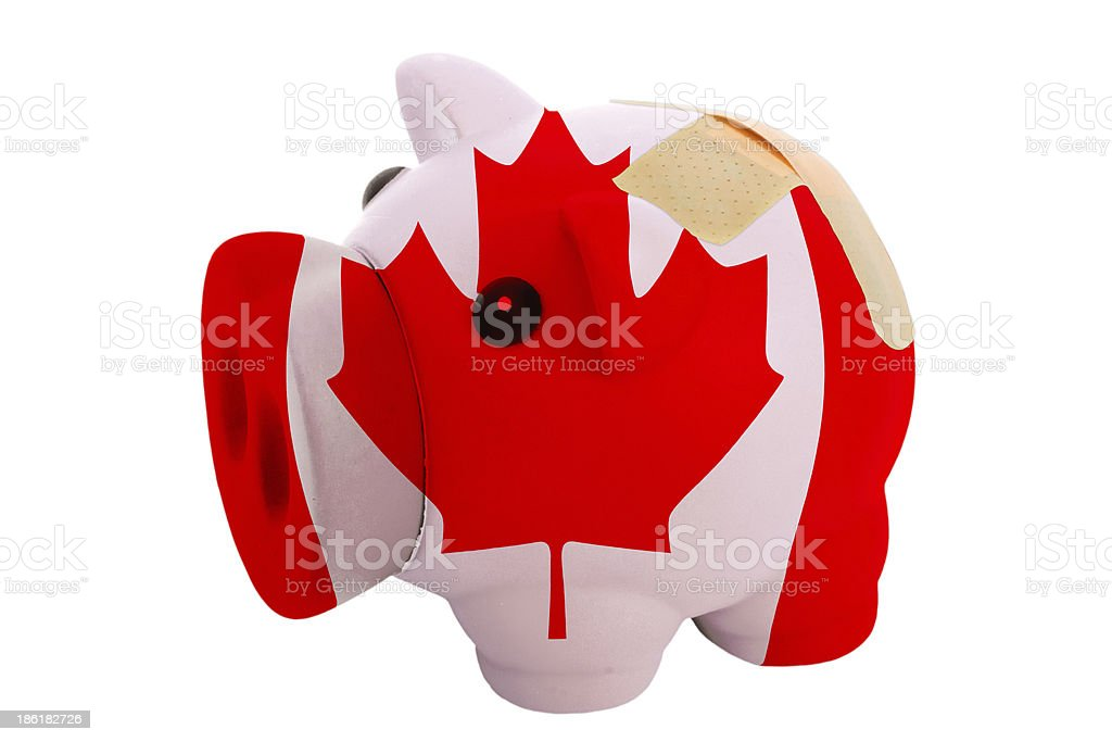 closed piggy rich bank with bandage in colors of canada royalty-free stock photo