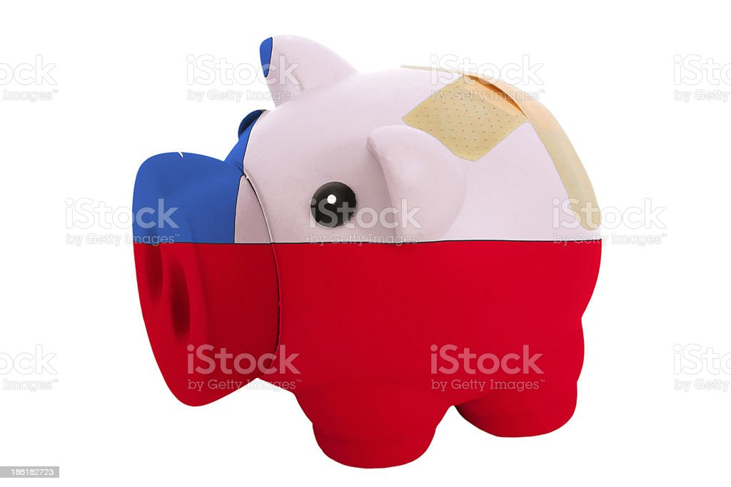 closed piggy rich bank with bandage in colors of chile royalty-free stock photo
