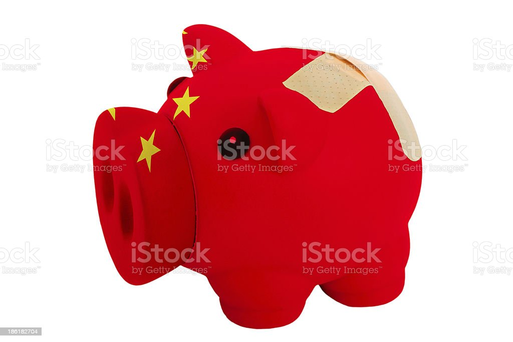 closed piggy rich bank with bandage in colors of china royalty-free stock photo