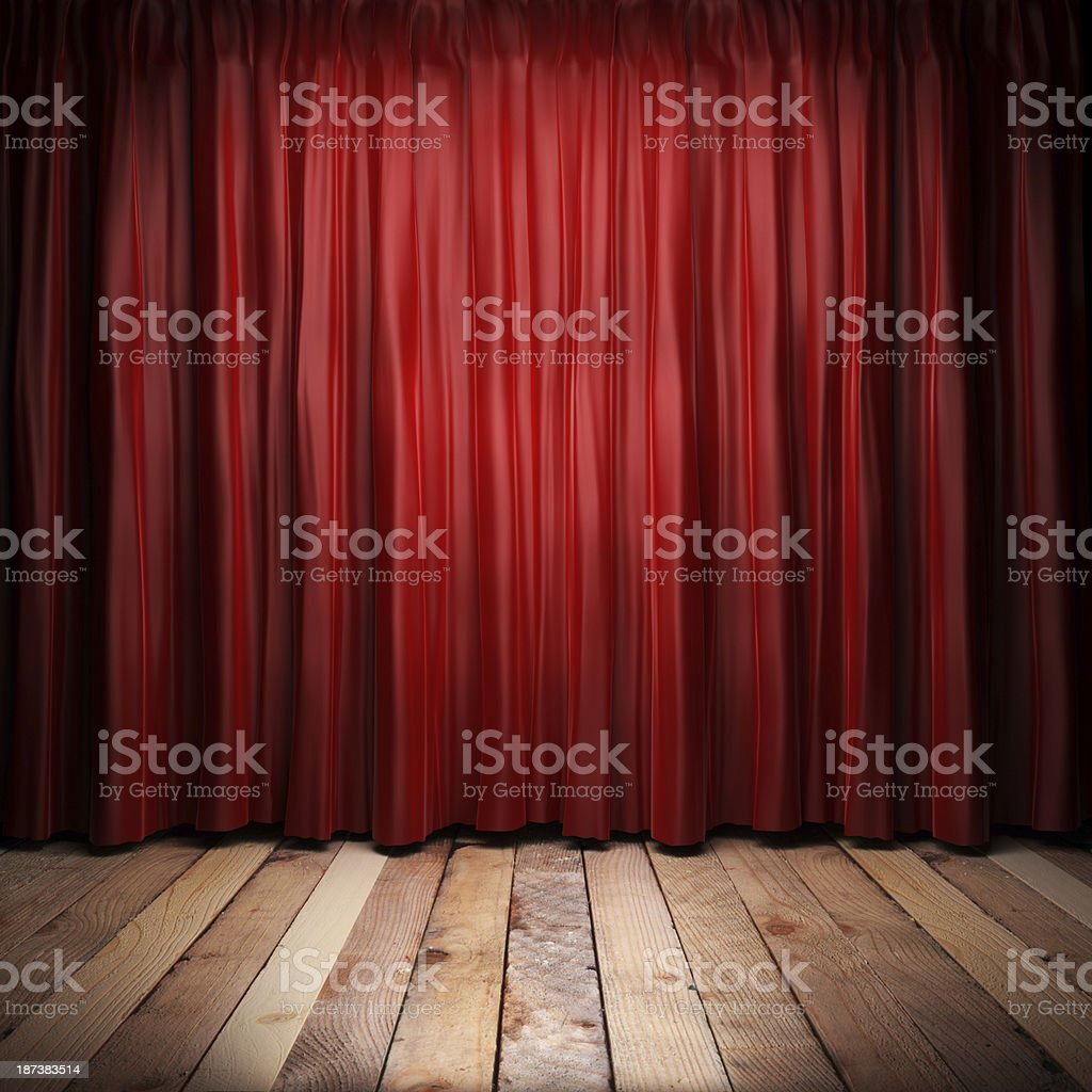 Closed red fabric theater curtains on a brown wooden stage  stock photo