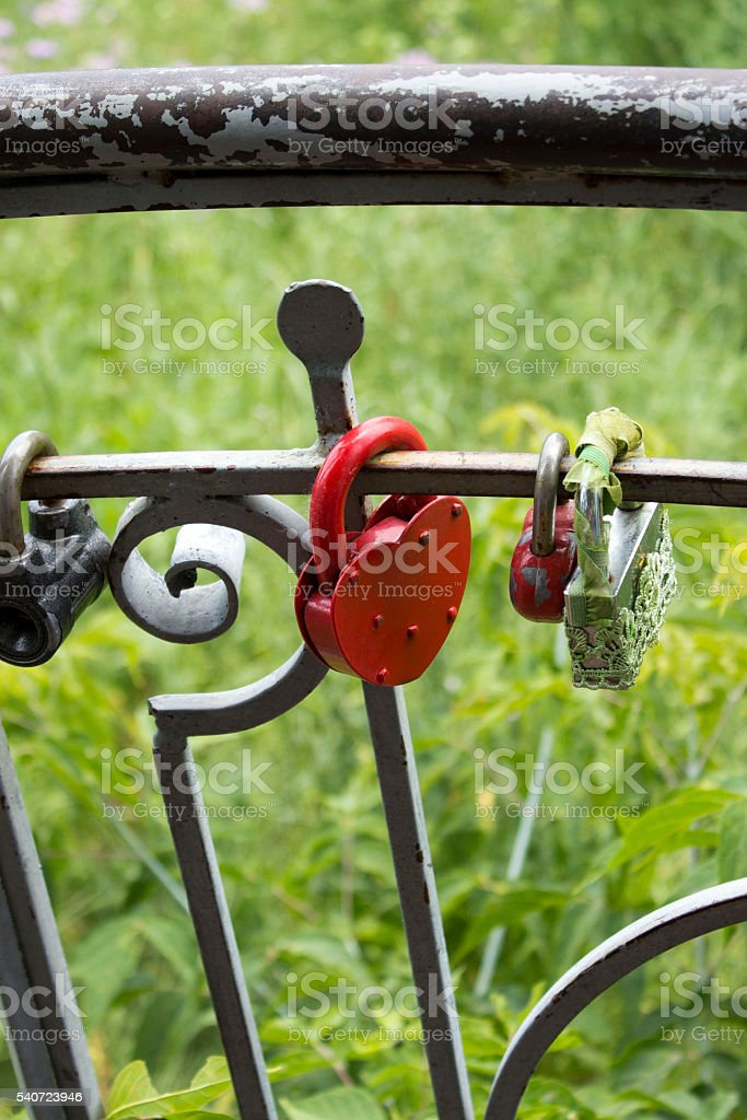 Closed red old lock hanging on the fence royalty-free stock photo
