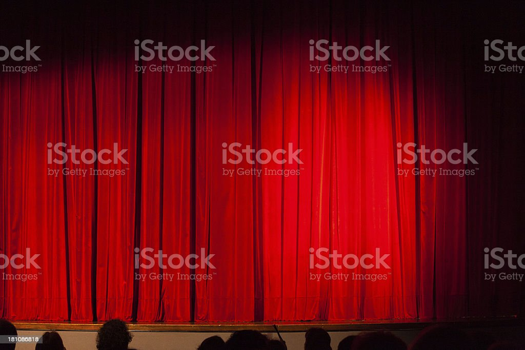 Closed Red Theatre Curtain and Spectators royalty-free stock photo