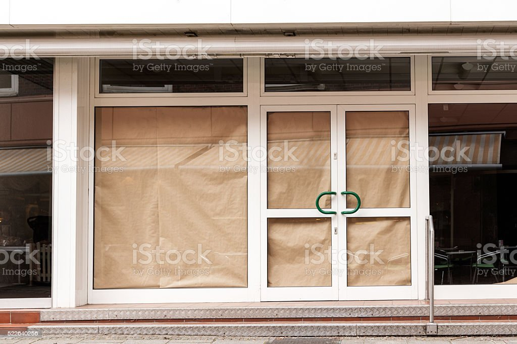 closed retail store after insolvency in the downtown area stock photo