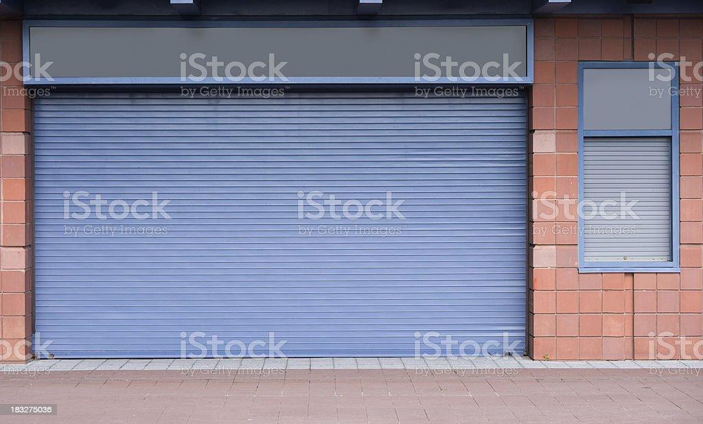 Closed rolling steel doors stock photo