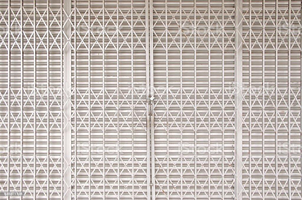 Closed shutters and metal accordion gate foto de stock libre de derechos