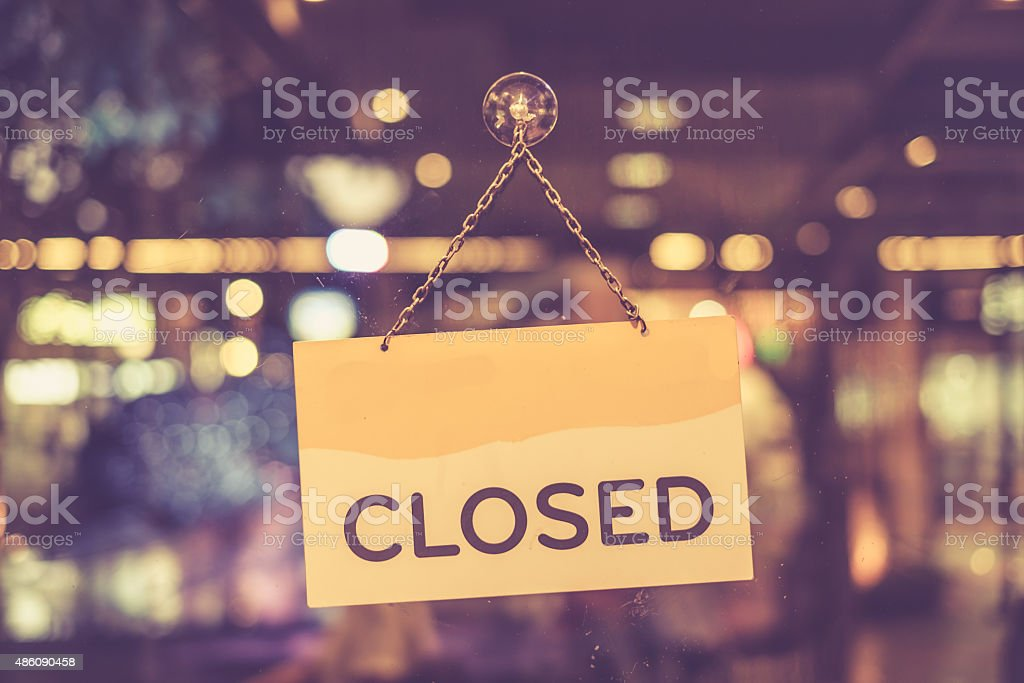 Closed sign hanging in a shop window stock photo