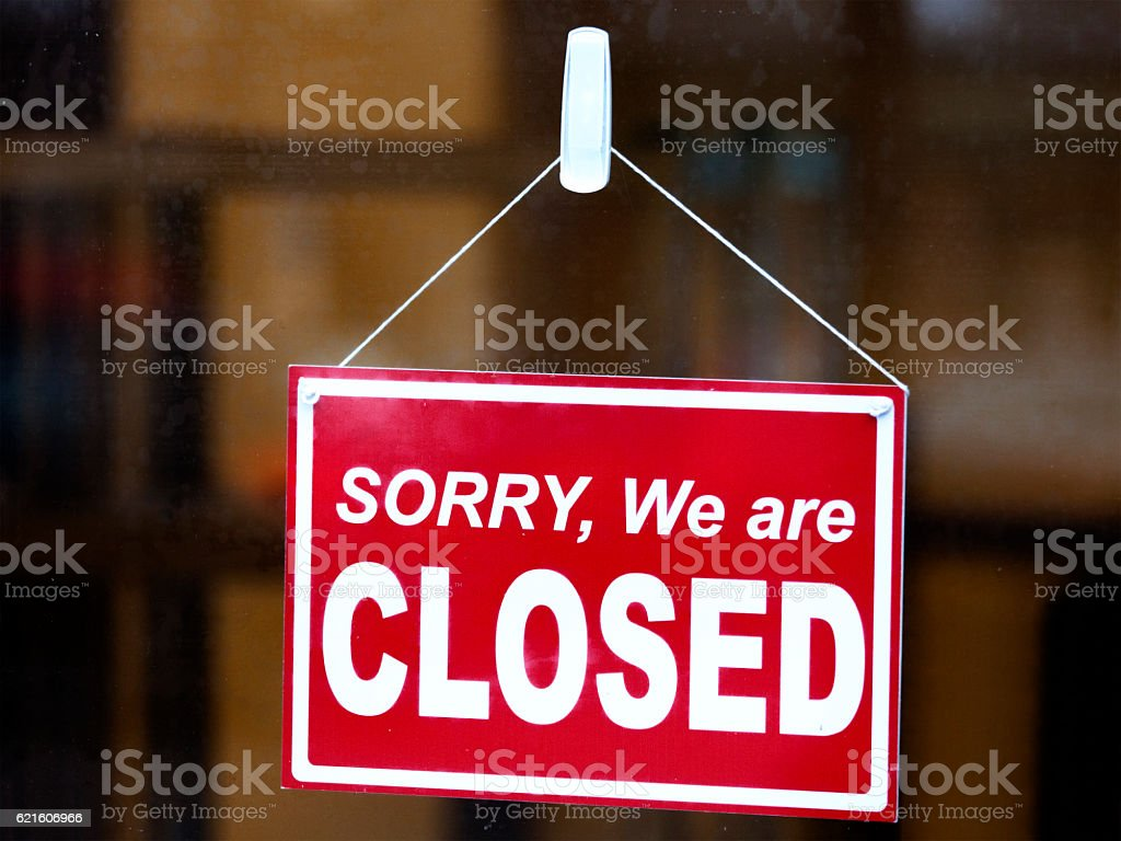 Closed Sign in a Shop Window stock photo