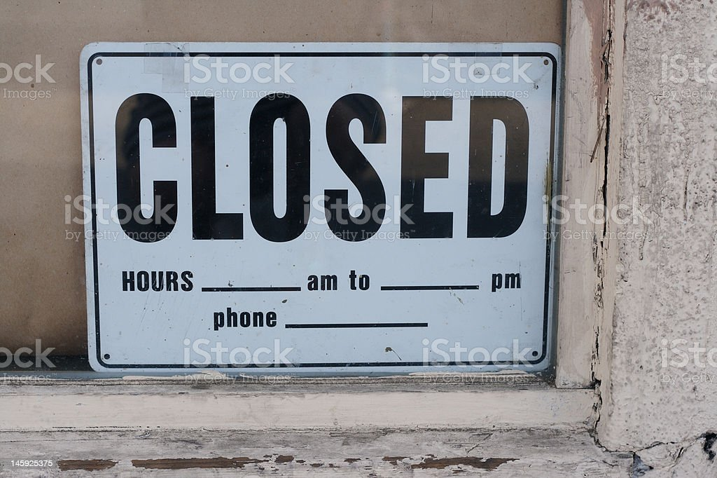 Closed sign in an abandoned shop royalty-free stock photo