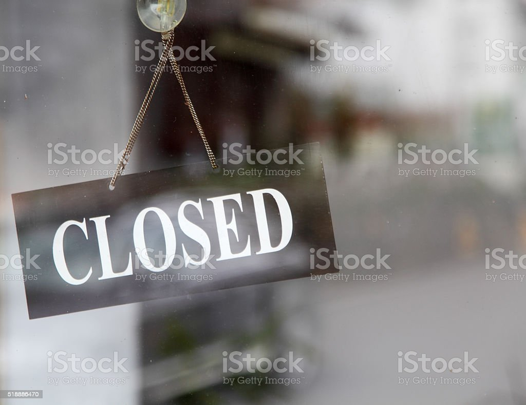 closed sign in shop window stock photo