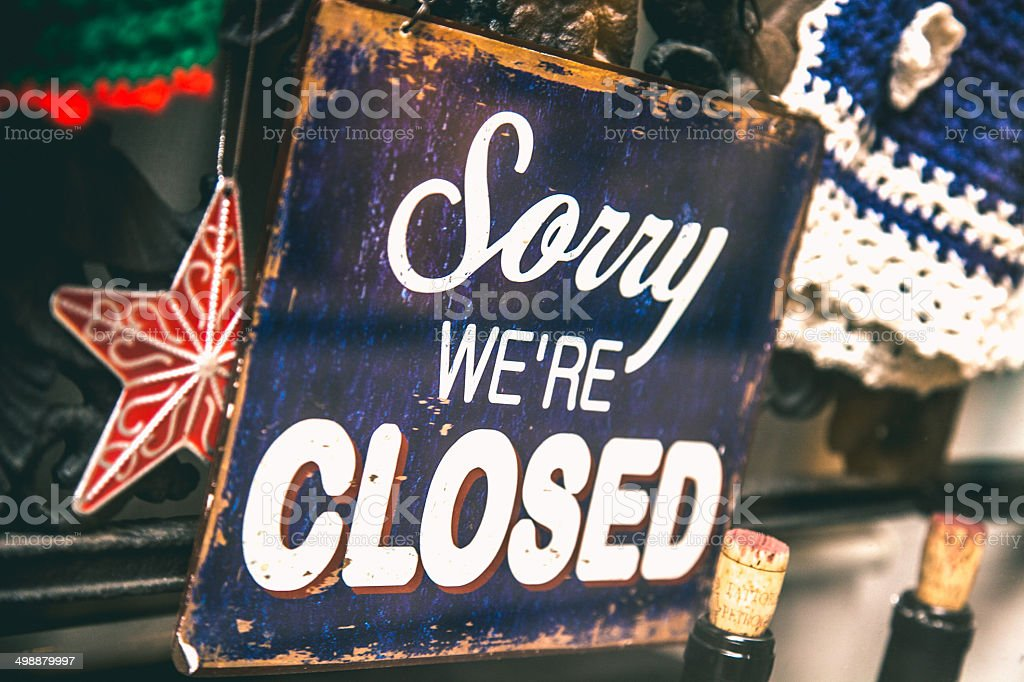 Closed sign on a shop window stock photo