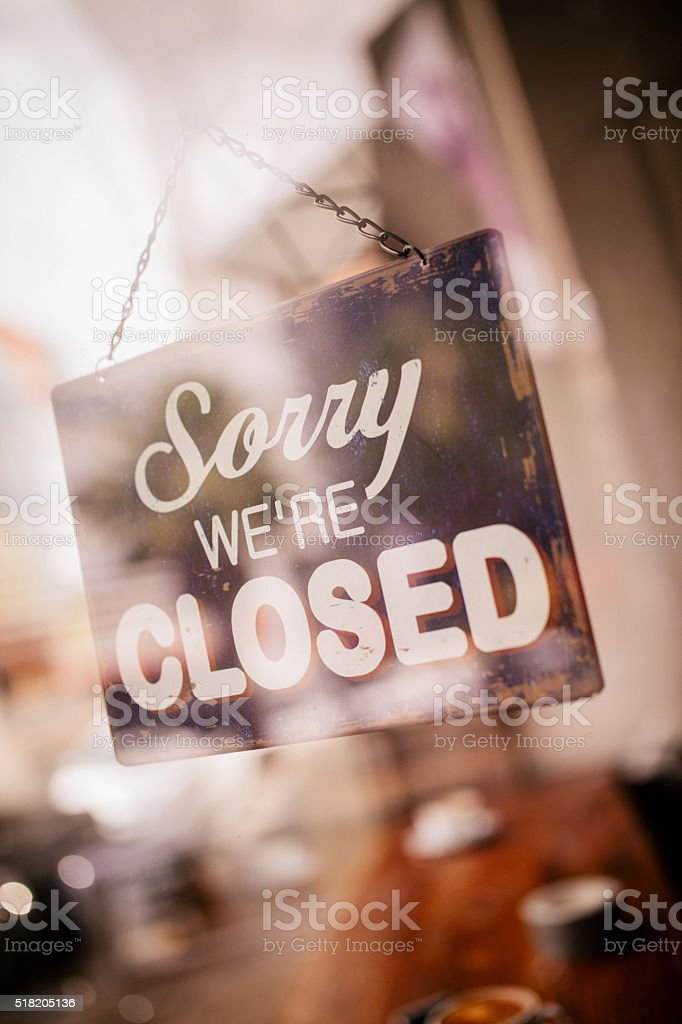 Closed Sign on Glass Door of Coffee Shop stock photo