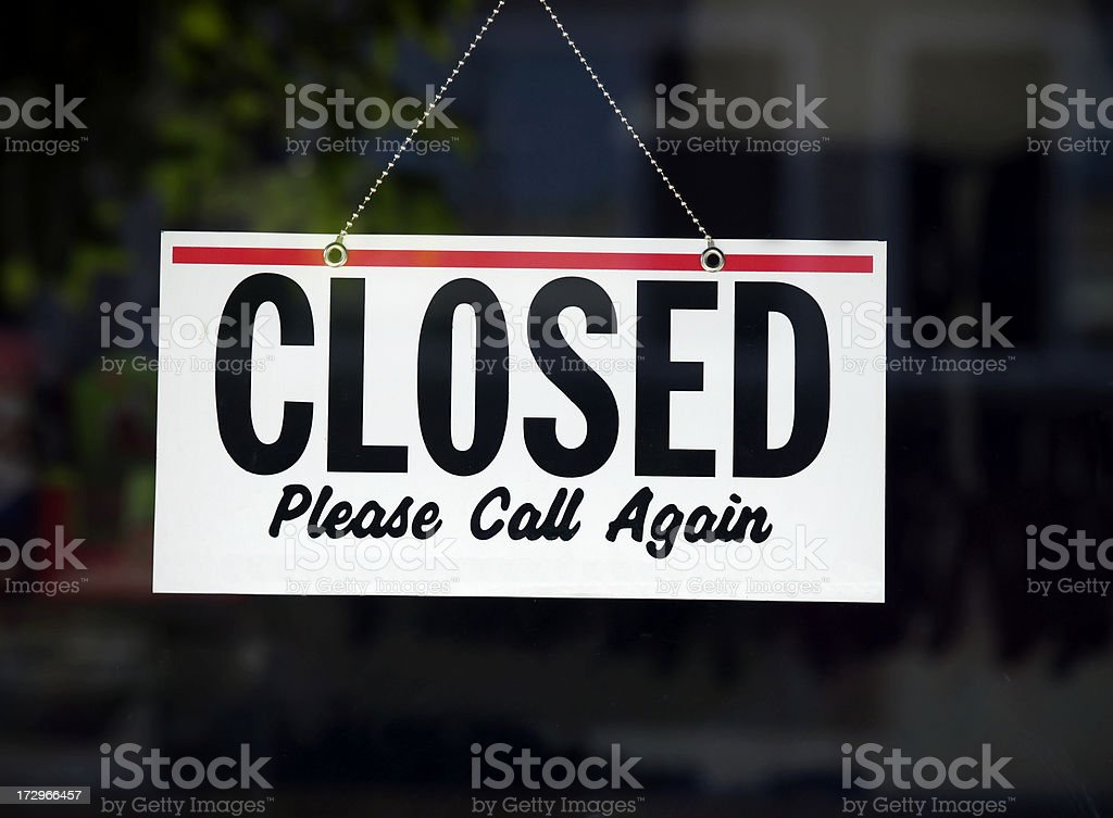 Closed sign on store window royalty-free stock photo