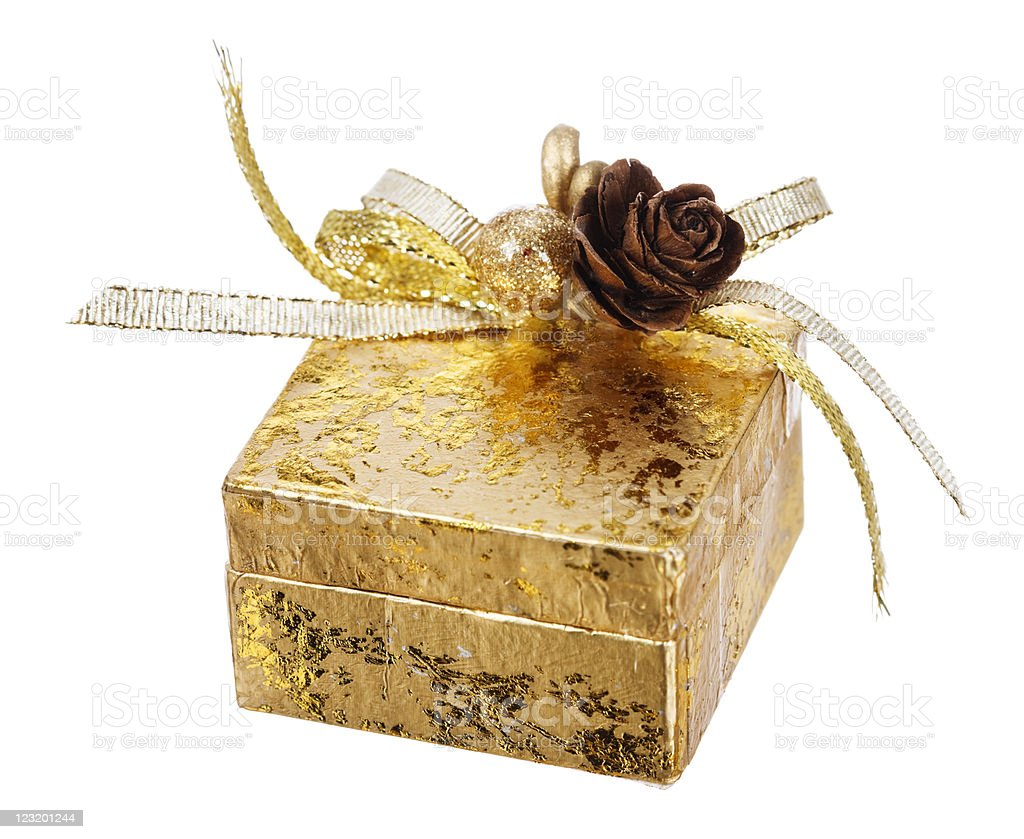 Closed square gold gift box on white royalty-free stock photo