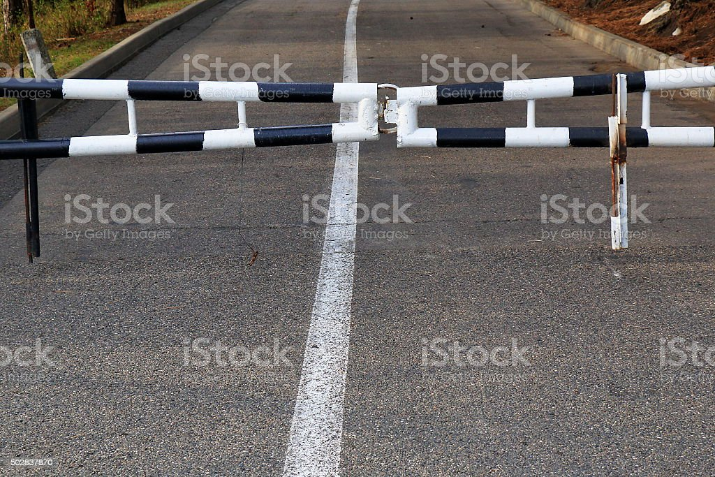 Closed striped road barrier on the way stock photo