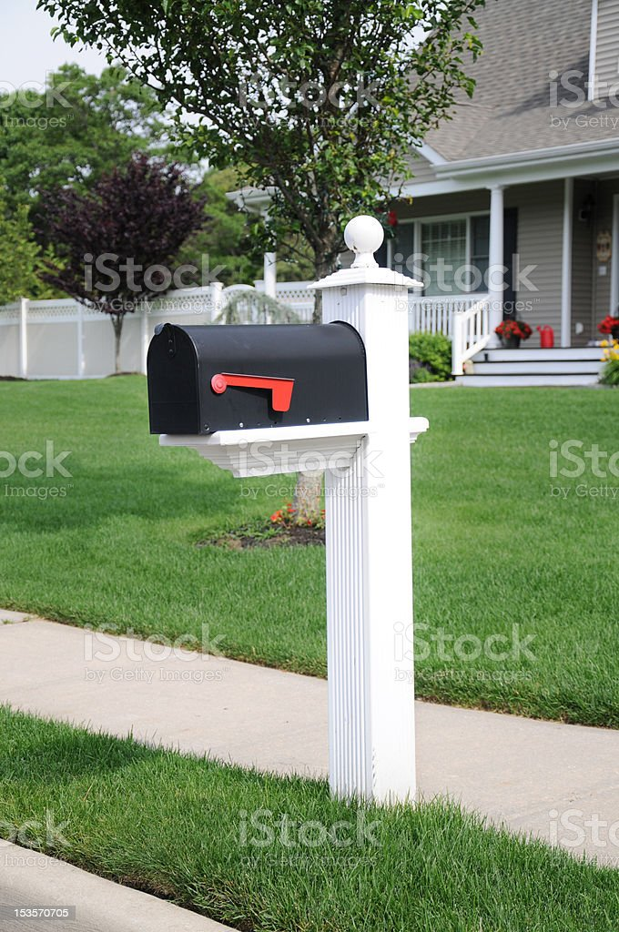 Closed Suburban Residential Mailbox Lush Green Lawn stock photo