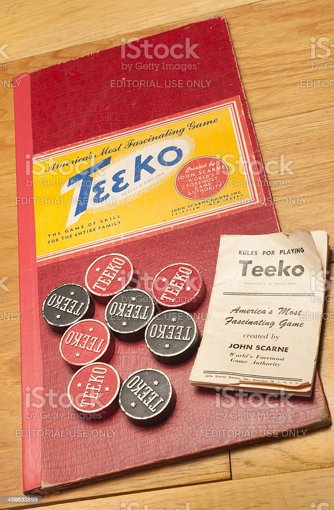 Closed Teeko Board Game with Pieces and Rules royalty-free stock photo