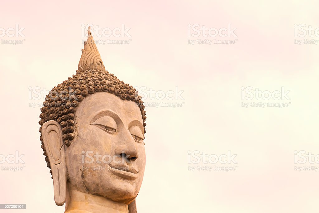 Closed up Face of Buddha Statue stock photo