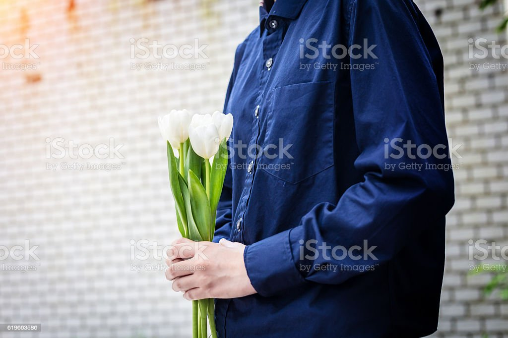 closed up hand hold tiny beautiful white flower stock photo