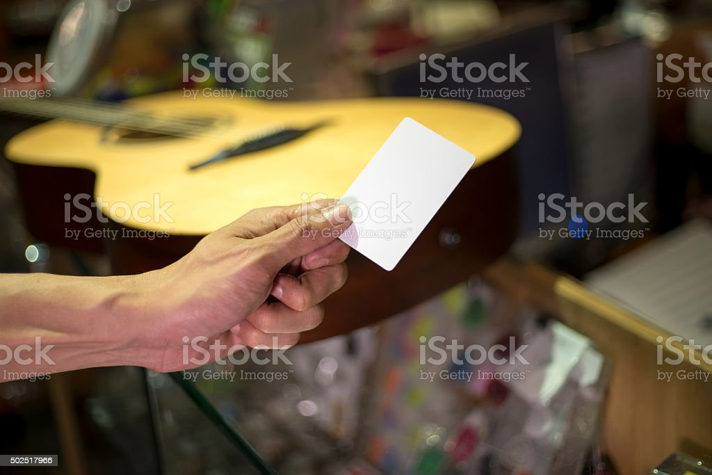Closed up hand holding credit card buying stock photo
