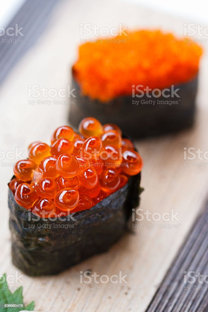 Closed up Ikura and Tobiko Sushi on the Stone Plate. stock photo