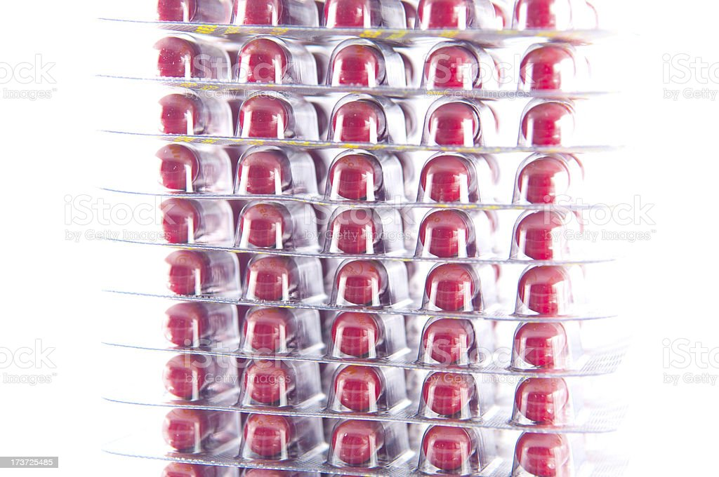 Closed up layer of red capsule in blister pack royalty-free stock photo