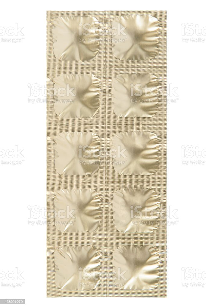 Closed up medicine tablet gold aluminum foil strip royalty-free stock photo