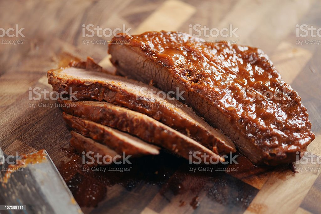 Closed up of sliced brisket on wooden cutting board stock photo